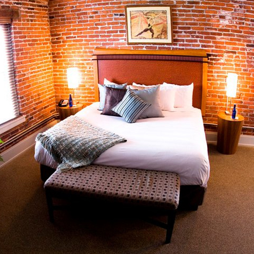 bed in brick room