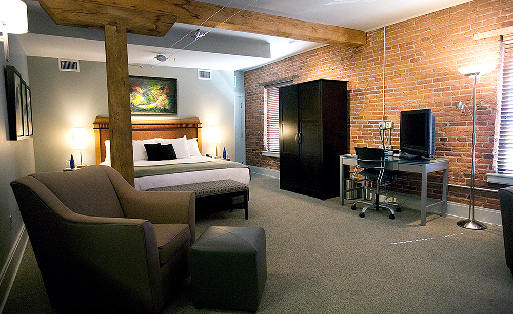 brick walled hotel room