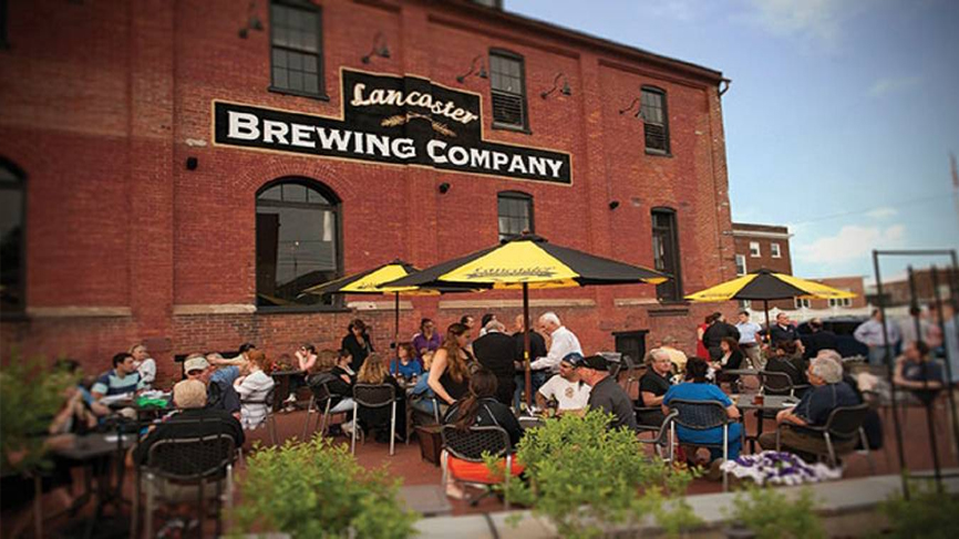 lancaster brewing company deck with people at tables
